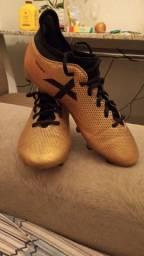 Chuteira Adidas X Dourada
