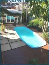 Casa Alto Padrão, 3 dormitórios, 2 suítes, 4 banheiros, jardim com piscina
