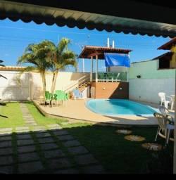Alugo para temporada casa com piscina em Guriri frente pro mar a 280m do centro