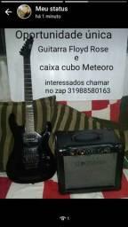 Guitarra e caixa cubo