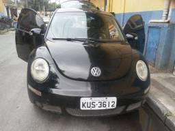Vendo carro new beetle e um fliperama