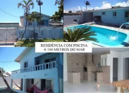 Linda casa duplex com piscina localizada no Balneário Praia de Leste, REF.:2842R