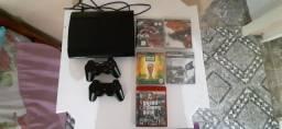 PlayStation 3. Jogos e 2 controles.