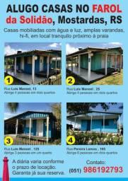 Casas na praia do Farol da Solidão