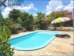 Casa com 4 dormitórios, 244m², jardim com piscina, salão de festas, Esteio