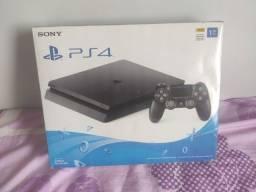 Vendo Playstation 4 slim com 2 controles com 1 tera de HD com mais de 163