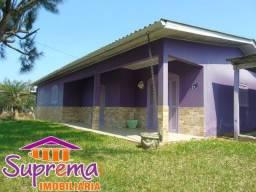 51 98252.00.33 C1200 Casa em esquina na Praia de Ipiranga Imbé