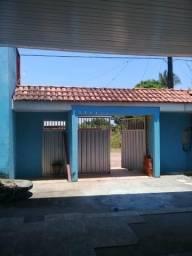 Casa com ponto comercial titulada bem localizada no bairro Novo Horizonte.