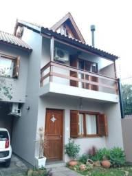 Casa à venda com 3 dormitórios em Guarujá, Porto alegre cod:LU429374