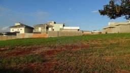 Terreno residencial à venda, Condomínio Terras do Cancioneiro, Paulínia - TE0370.