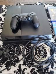 PS4 com um controle e 4 jogos