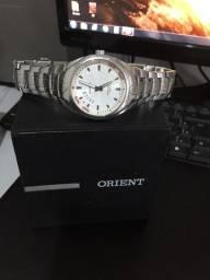 Relógio Orient bem conservado