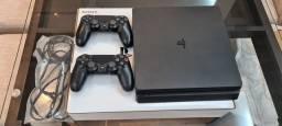 Playstation 4 de 1 Tb e dois controles + 3 jogos.
