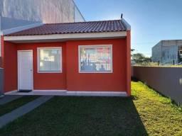 JM* casa com a entrada parcelada , 2 dormitórios , vaga de garagem , quintal atrás