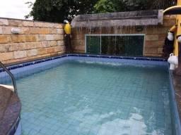 Título do anúncio: Condomínio Horizontal Cidade Jardim I. Casa com 4 suites sendo 1 máster, piscina