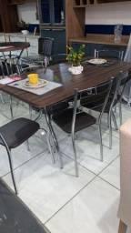 Mesa Flavia 137×75 c/ 6 Cadeiras ? Fil Tubulares ? Nogueira Marrom<br><br>
