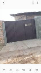 Vendo uma  casa  no bairro Cidade satélite bem localizado todo murado  e bem localizada