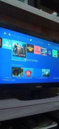 PS4 com alguns jogos.