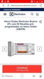 Título do anúncio: Troco microondas novo