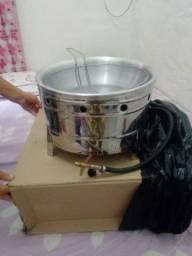 Máquina de batata nova na caixa