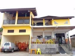 Casa e comercio de portas fechadas 2.000 m2