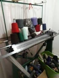 Máquina de tecer roupas