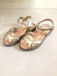 Título do anúncio: Sandália dourada tamanho 24 Milon