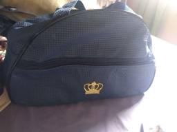 Vendo bolsa e saída de maternidade ou troco por fraldas tamanho P