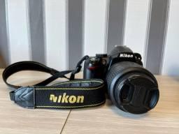 Máquina Nikon + flash triopo