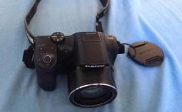 Máquina fotográfica com bolsa