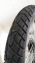 Peneul de bros 160 com freio a disco nas rodas