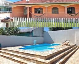 Casa para Temporada com piscina em Guaratuba/PR - Balneário Coroados - Ref. 1071