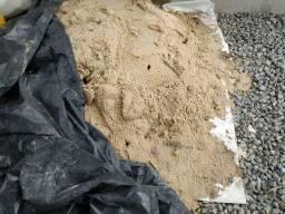 Doa-se areia de praia.