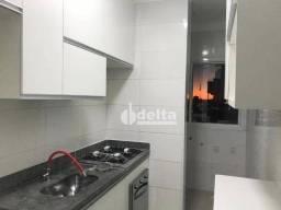 Apartamento com 2 dormitórios para alugar, 60 m² por R$ 1.000/mês - Santa Mônica - Uberlân