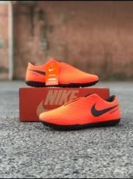 Chuteira Nike Laranja Tiempo