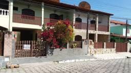 Emannoel Imóveis - Ótima casa em condomínio junto ao centro de Iguaba