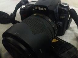 Câmera fotográfica Nikon d90 + lente 18-105 mm + flash + tripé com cabeça hidráulica.