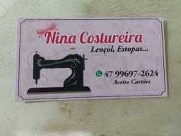 Nina costureira