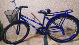 Vendo bicicleta seme nova.ou troco por celular iPhone eu dando uma volta em dinheiro?