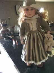 Vendo essa linda boneca de porcelana antiguidade nova