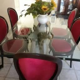Mesa de vidro . Base escultura de pedra. 6 cadeiras de jacaranda