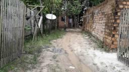 Vendo terreno com 1 casa e uma construção