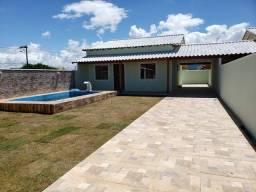 JD-Linda casa com piscina e área gourmet, dentro de terreno medindo 250m² em Unamar