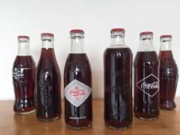 Coleção de garrafas históricas da Coca Cola