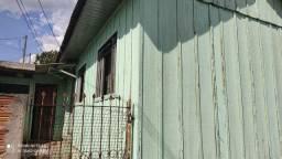 Alugo casa de madeira