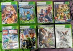 8 jogos do Xbox 360, e 2 controles