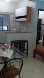Quitinete em Itapuã, mobiliado, garagem, excelente localização, pronto para morar.