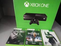 Xbox One com 03 jogos. Aceitamos video games como parte do pagamento