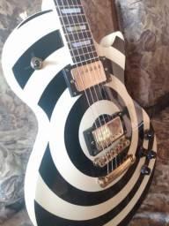 Guitarra Less Paul e caixa Behringer