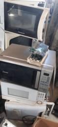 Microondas sucateados e usados